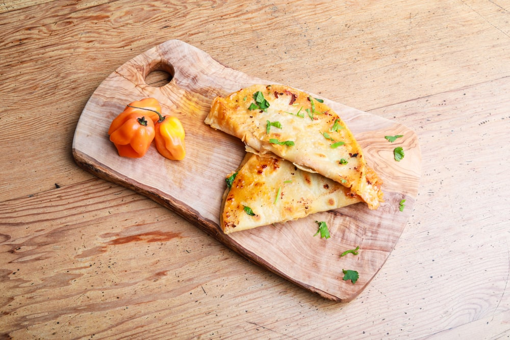 two omelettes on chopping board