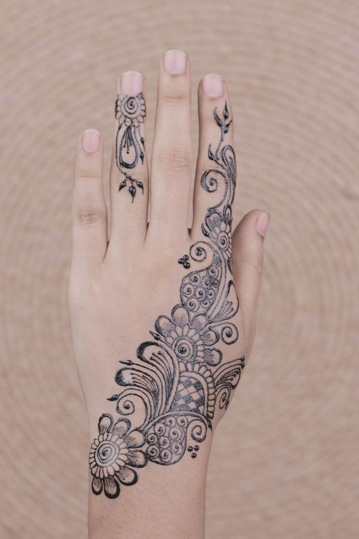 black Mendhi tattoo