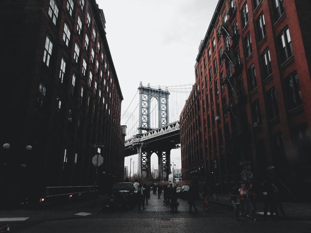 gray bridge near buildings