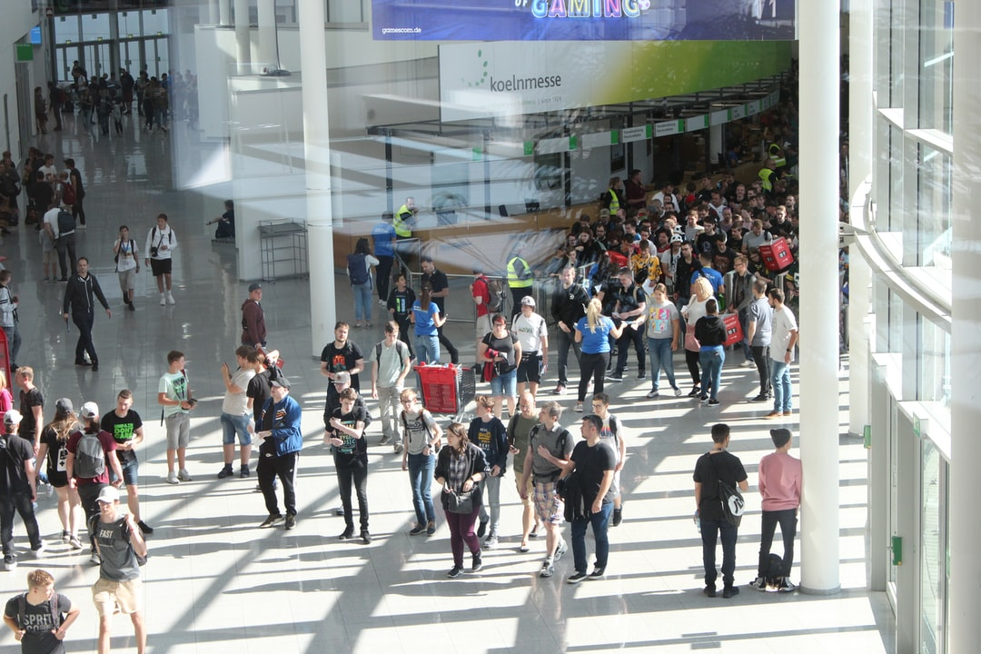 Young people entering Gamescom 2019 shot from an elevated position