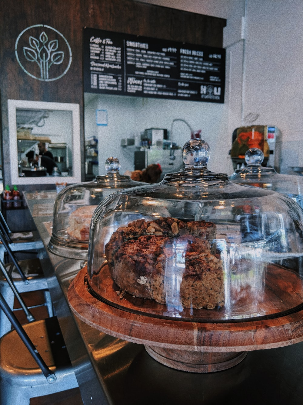 coffee shop sells two cakes inside dome glasses