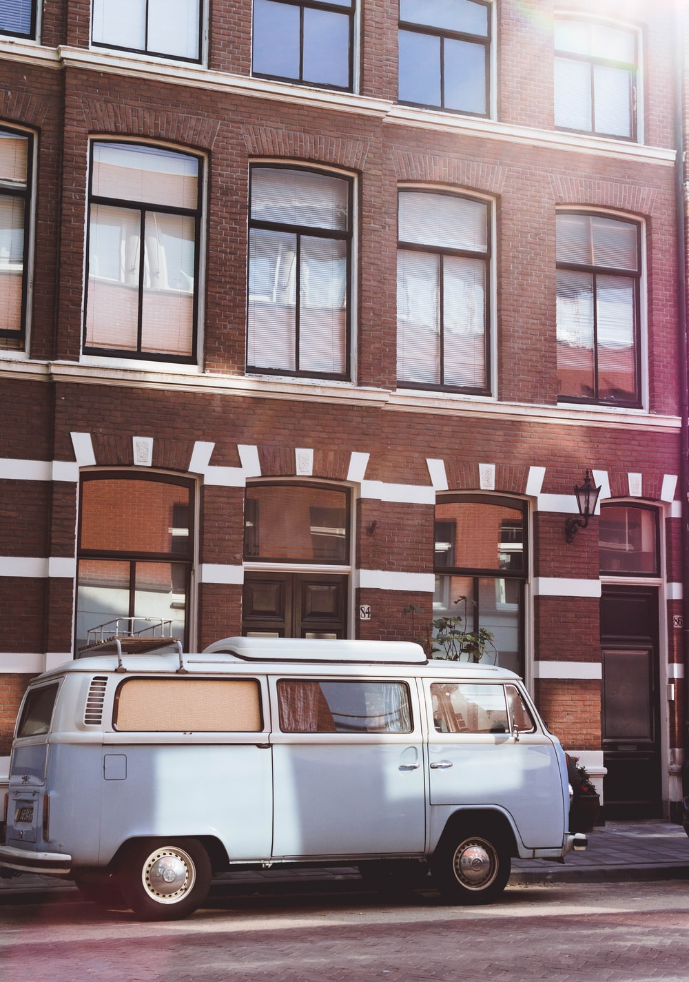 white van parking near building