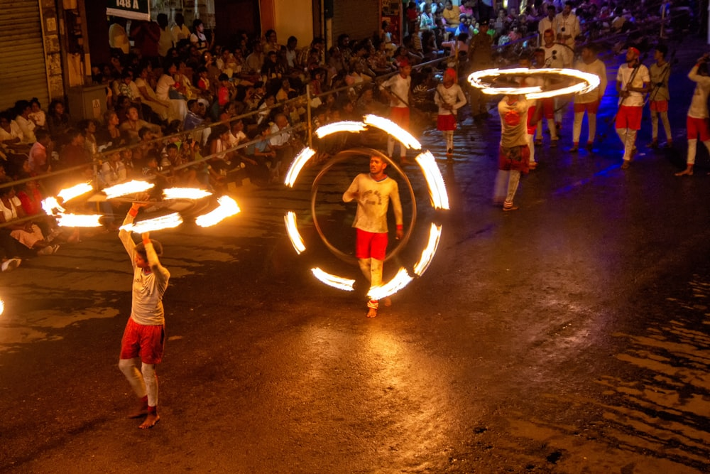 three person about to fire dancing