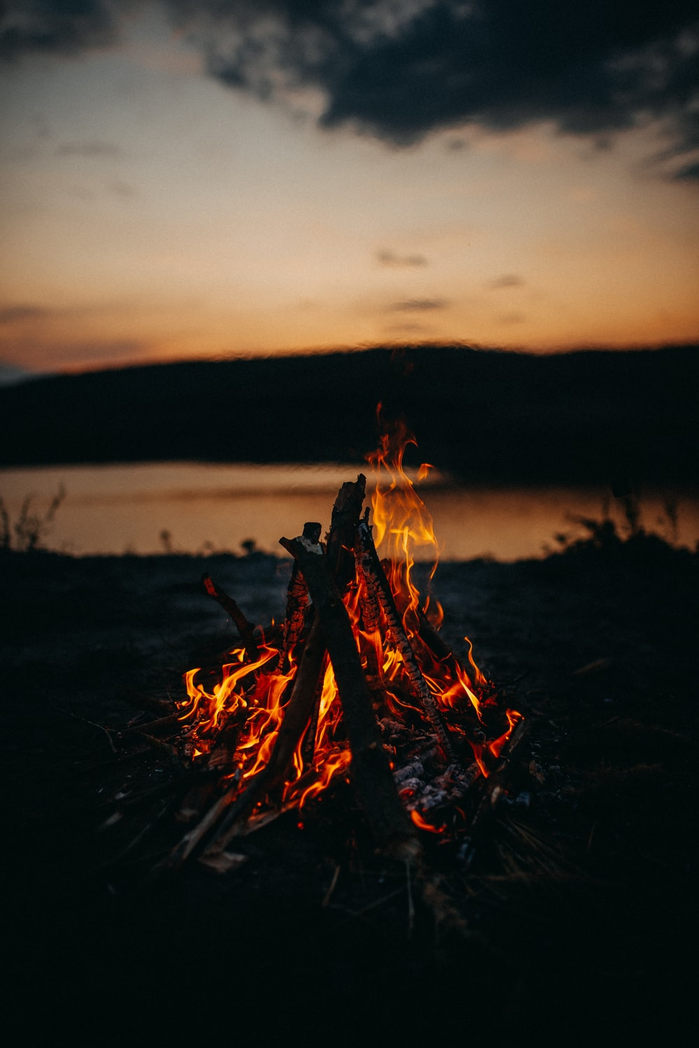 bonfire in green field during night time