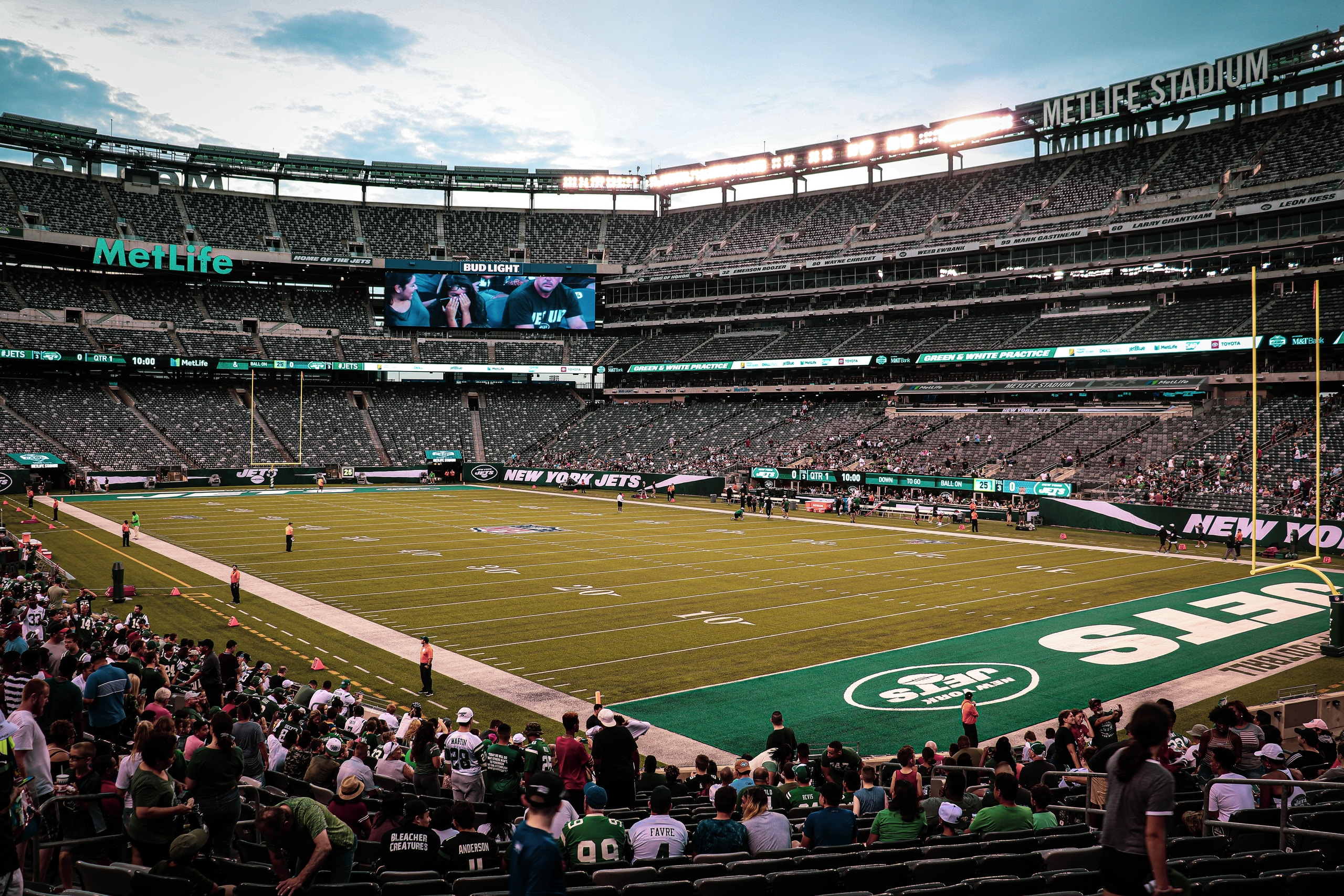 Nike, New York Jets, people on football stadium during daytime