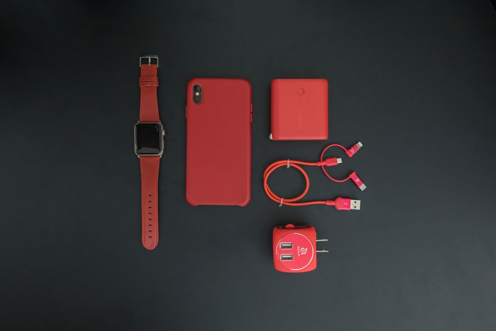 red iPhone and red smartwatch