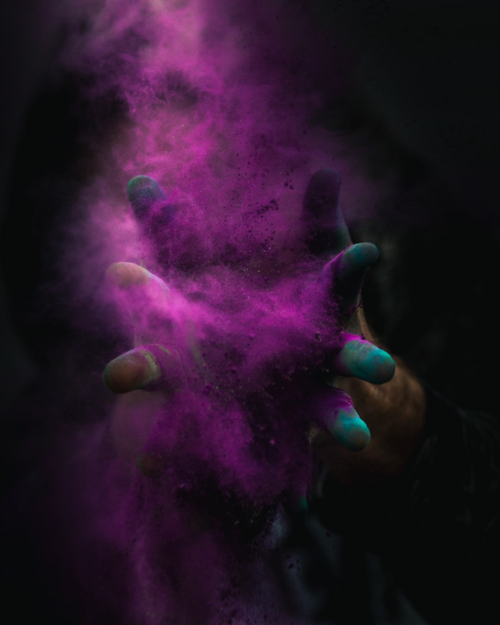 time-lapse photography of person spreading purple powder