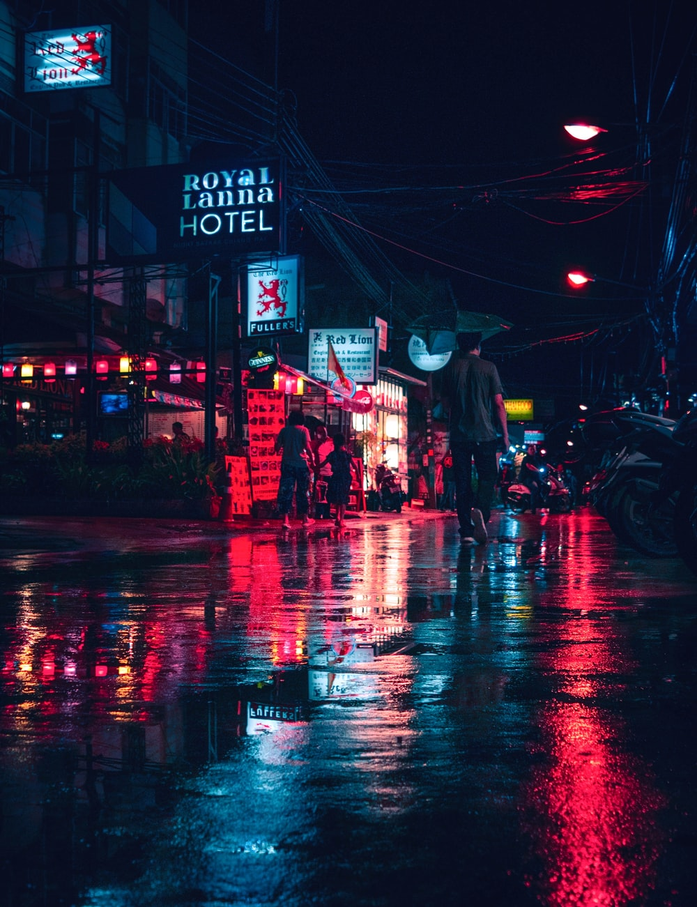 people walking on busy street during night time
