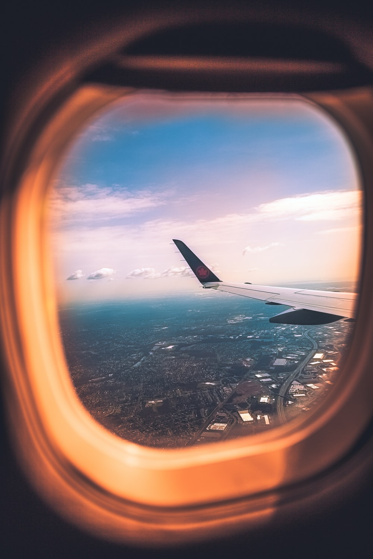 airplane window during daytime photo