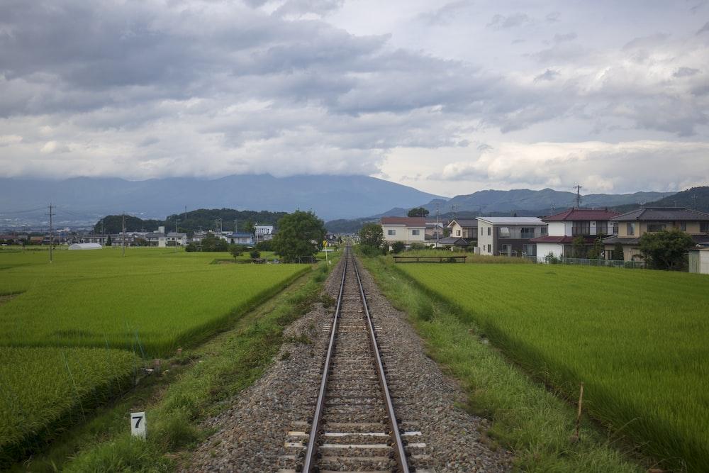 gray train rails during daytime photo