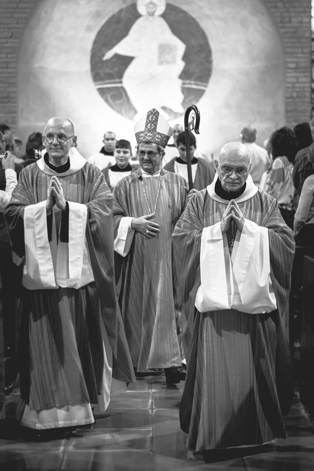 grayscale photo of priests