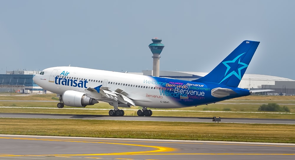 white and blue Transat airplane