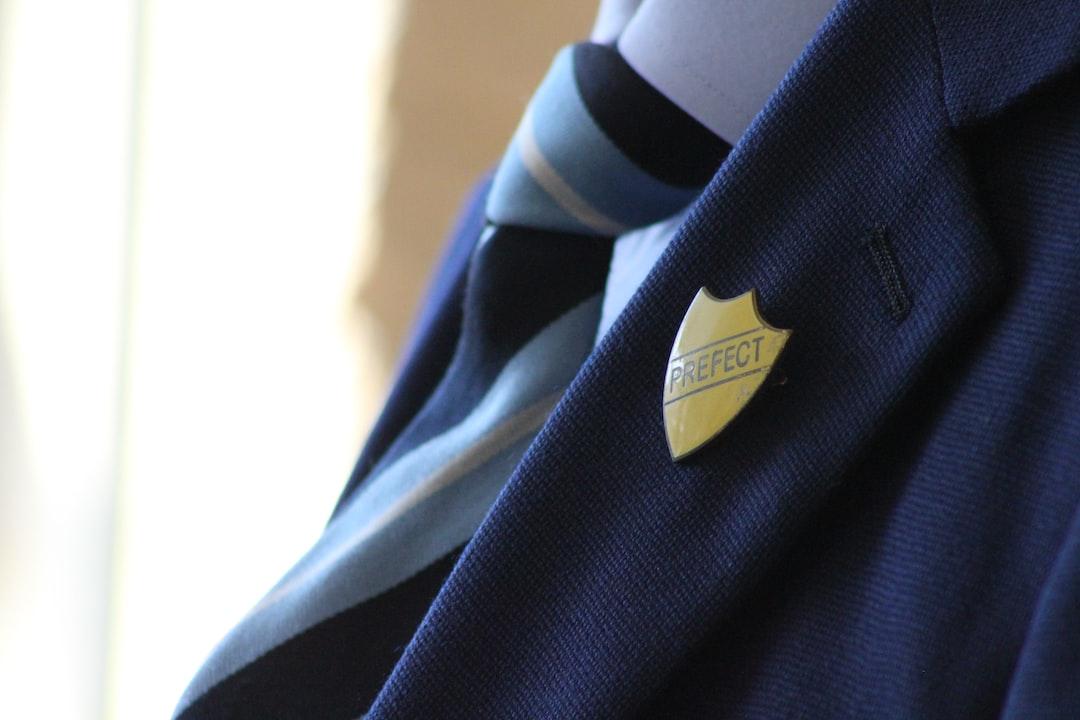 Vintage Prefect badge on old school uniform