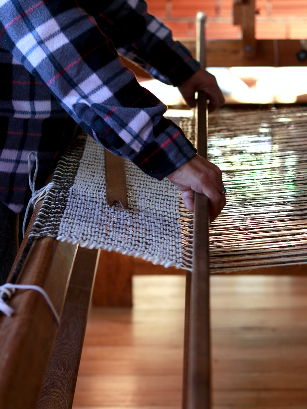 person weaving cloth