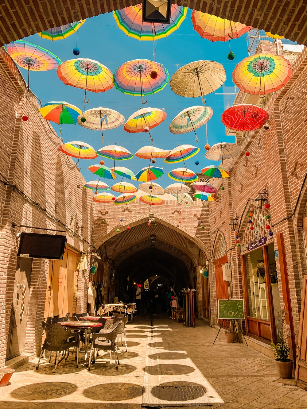 assorted-colored umbrellas hanging on alley