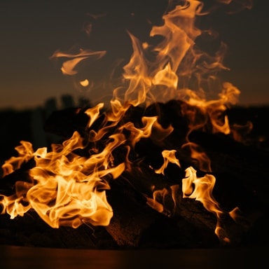 lit fire pit at night