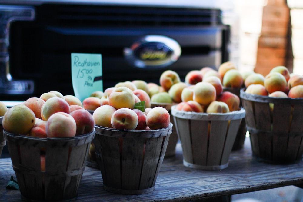 brown wooden buckets of apples
