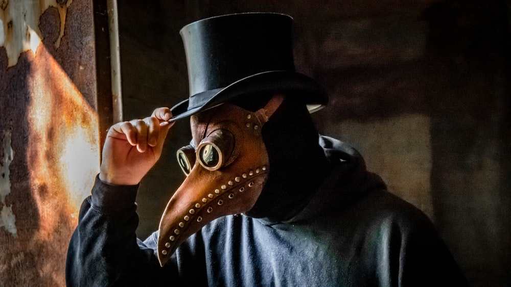 person wearing mask and hat