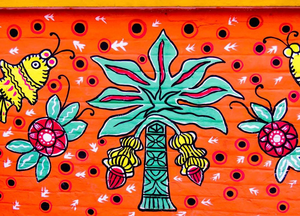 orange and green floral wall art