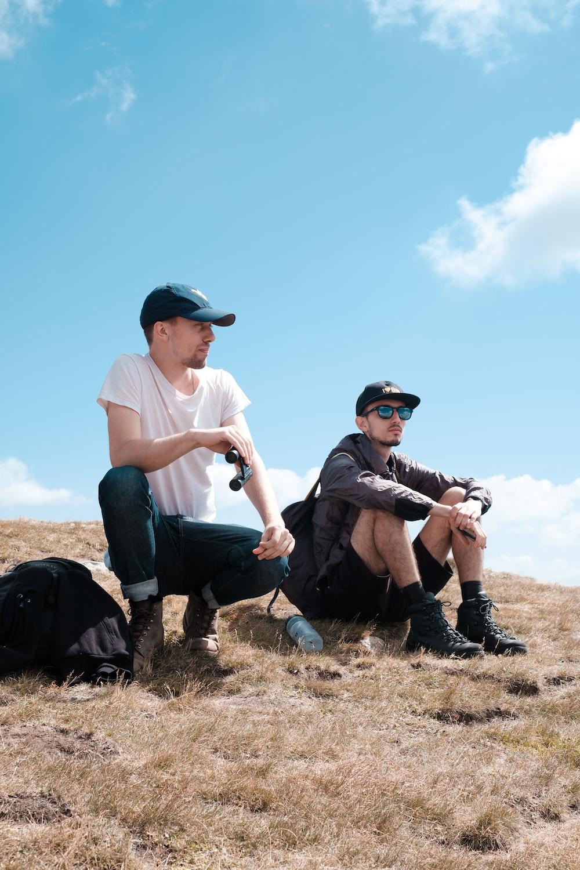two men sitting on hills
