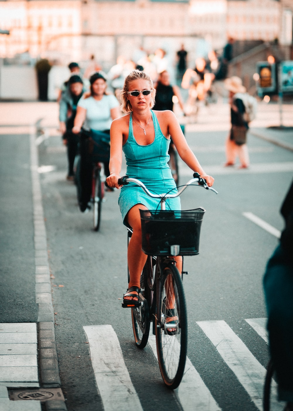 woman riding on black and gray road bike