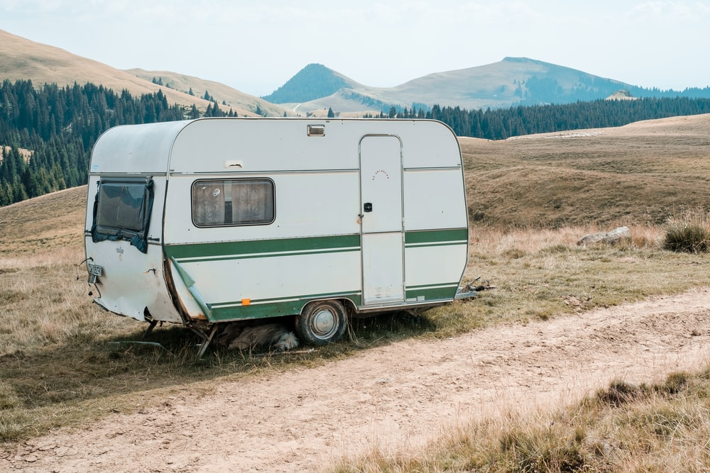 closed white camping trailer during daytime