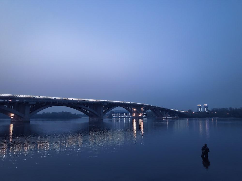 calm body of water near bridge