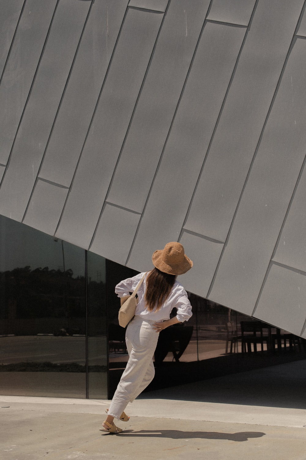 woman standing outside building