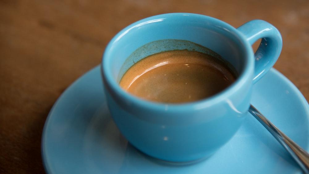 half-filled ceramic cup on saucer