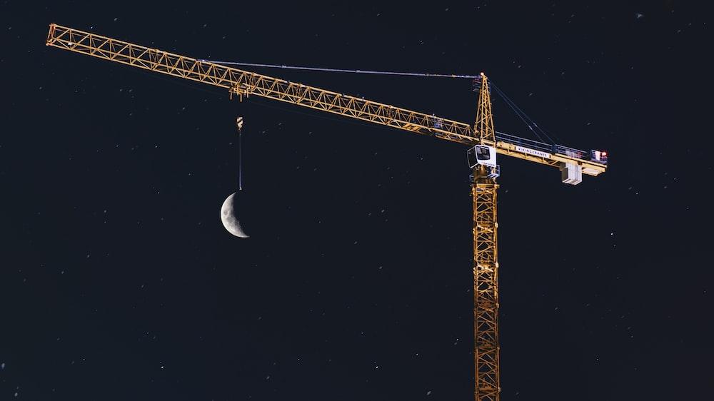 yellow crane during nighttime