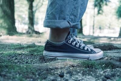 person wearing black low-top sneaker