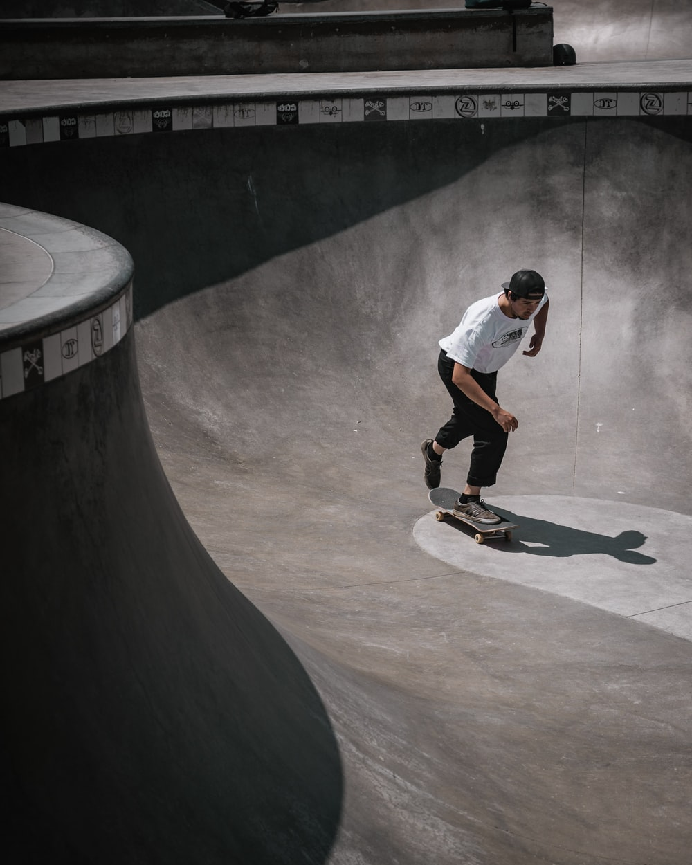 man wearing white shirt skateboarding