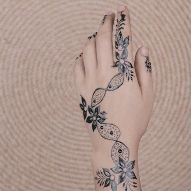lack floral mehndi tattoo