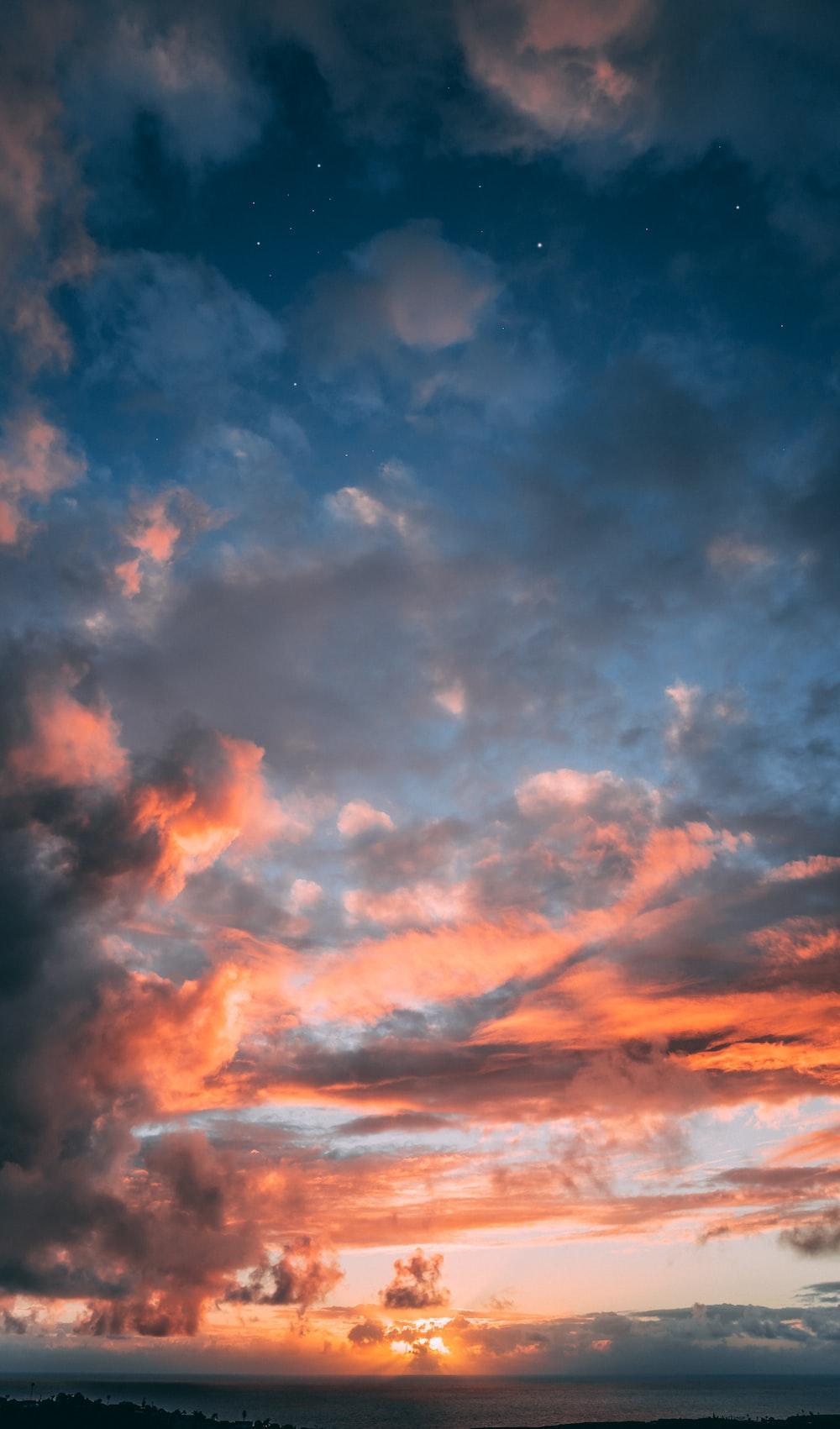 blue, orange, and gray skies