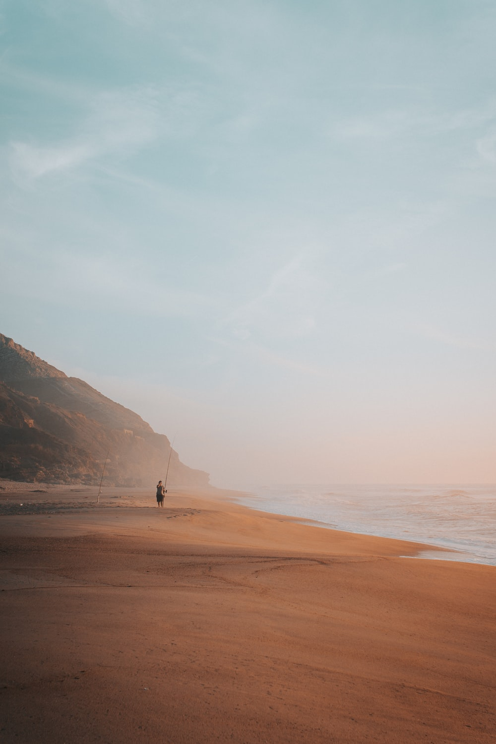 person on sand seashore during day