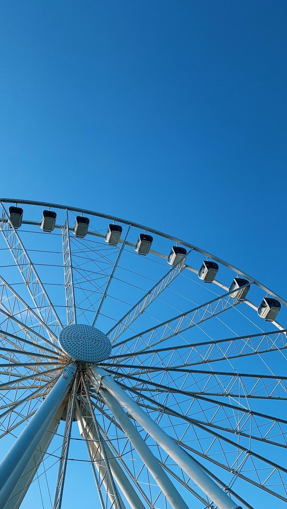 white Ferris wheel under blue sky