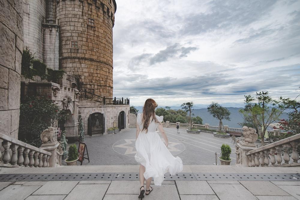 woman in white dress walking outdoors