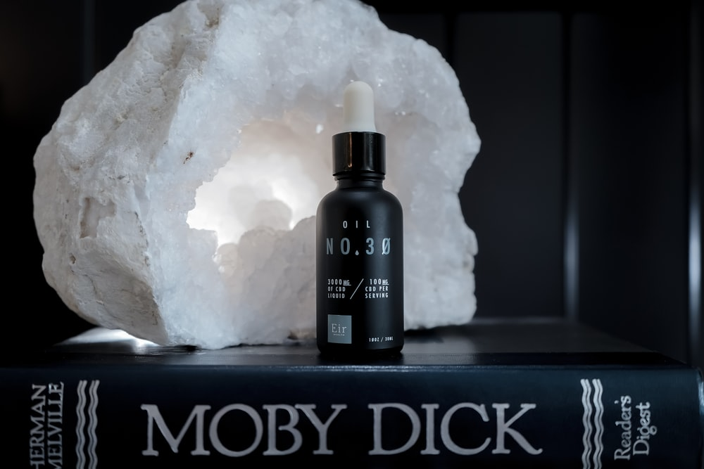 black bottle on Moby Dick book