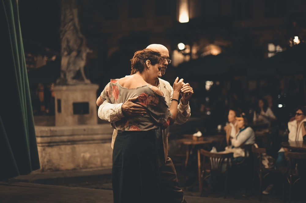 man and woman dancing inside building