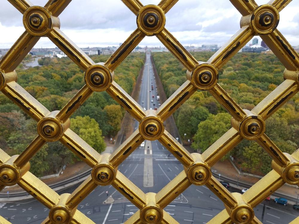 gold metal fence at daytime