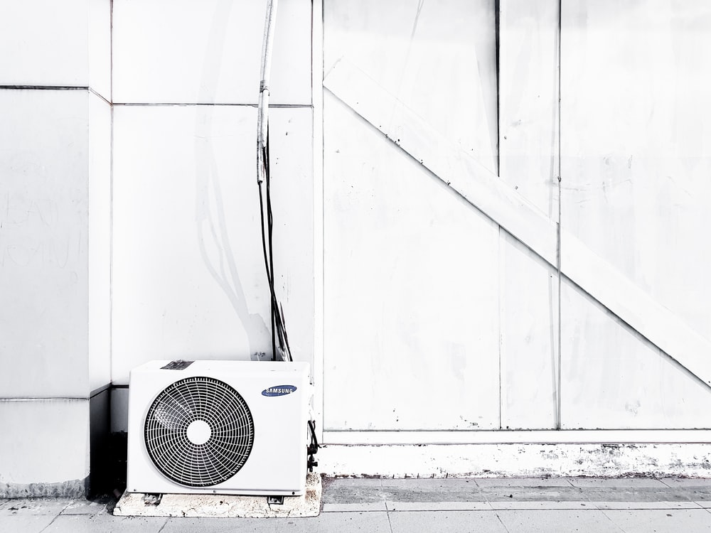 grayscale photography of outdoor AC unit