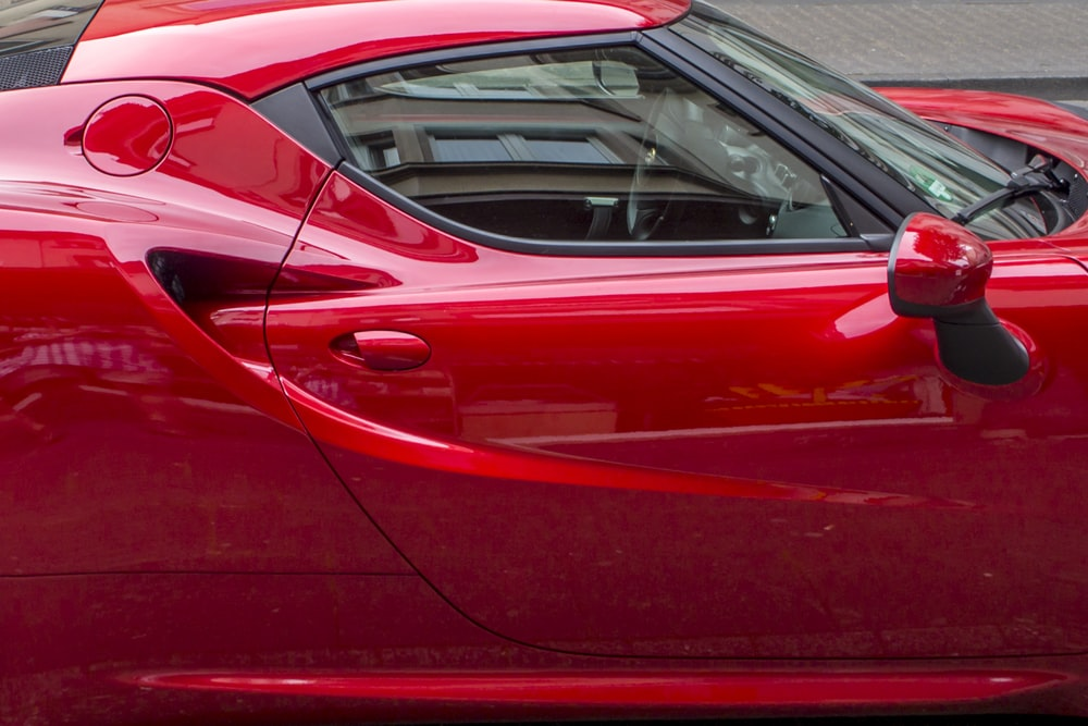 red coupe during daytime