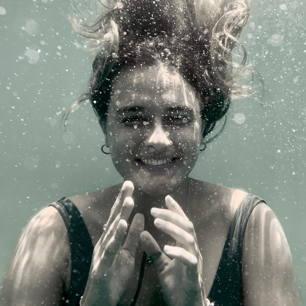 smiling woman underwater