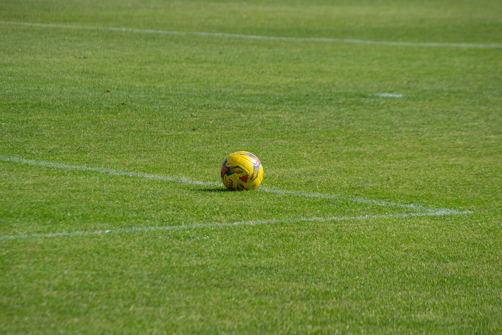 yellow soccer ball on field