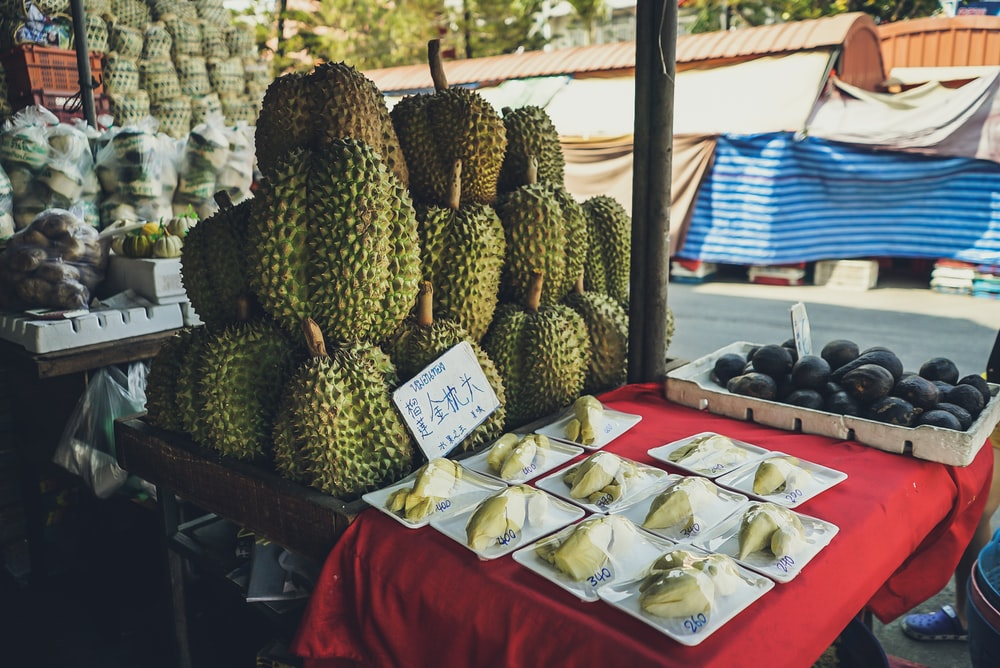 durian and fruits on table