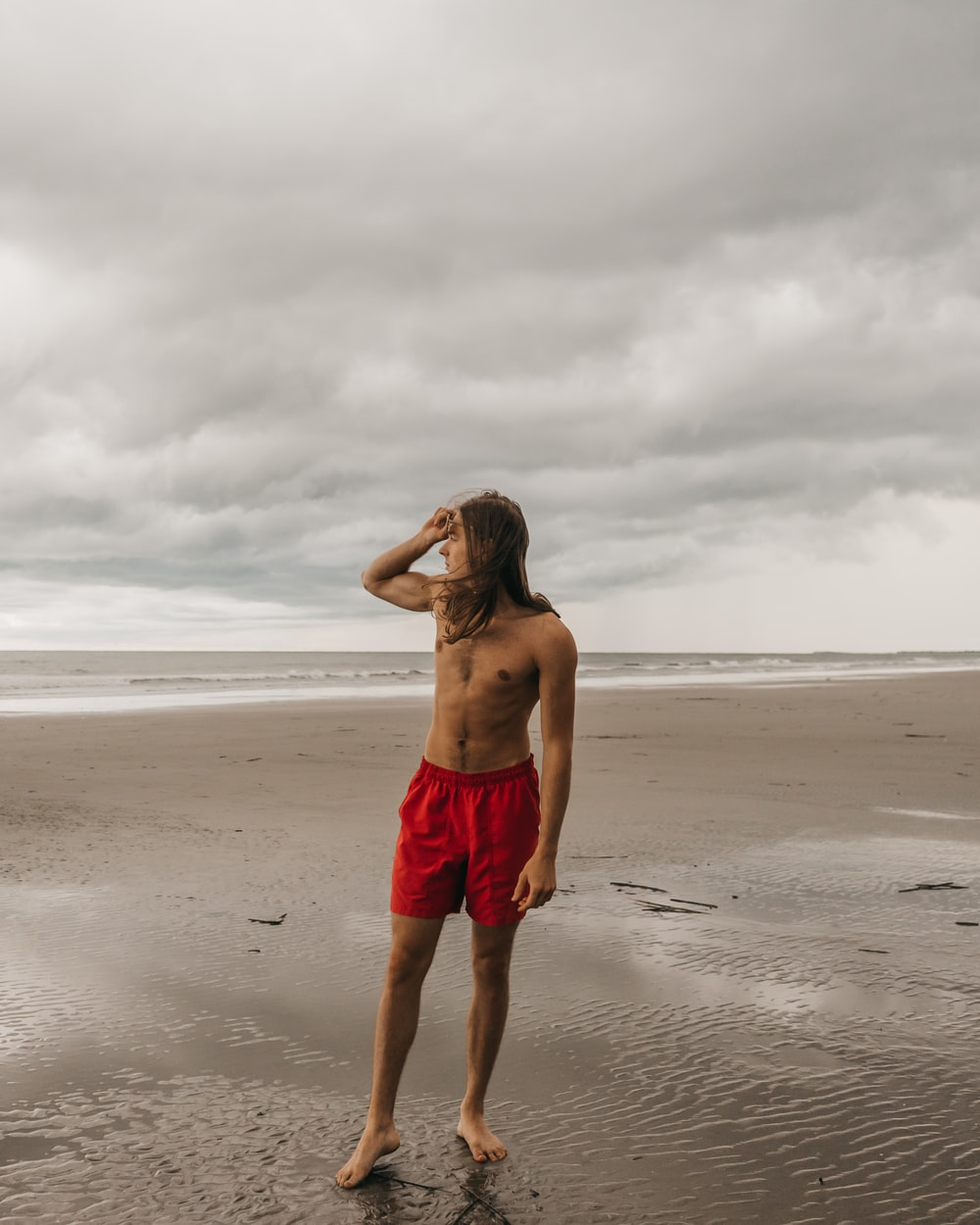 man in red shorts
