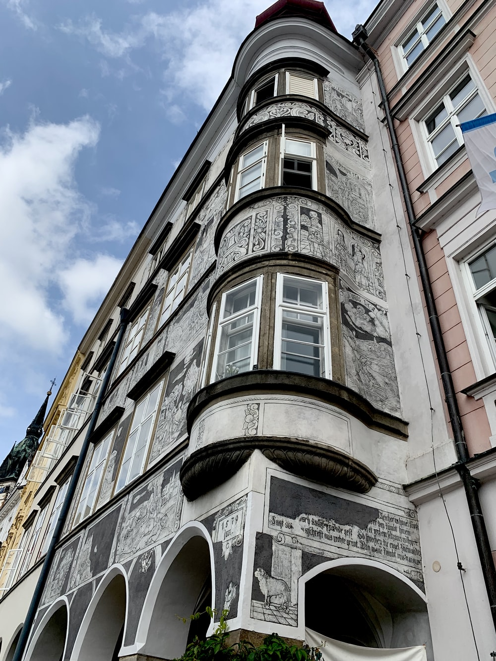 gray concrete building showing windows