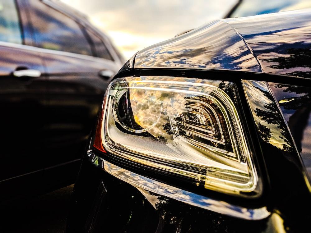 selective focus photo of vehicle headlight