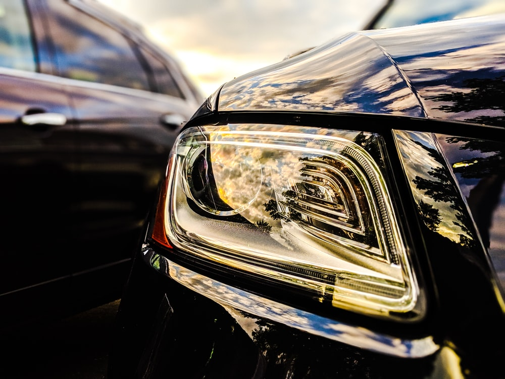 selective focus photo of vehicle headlight