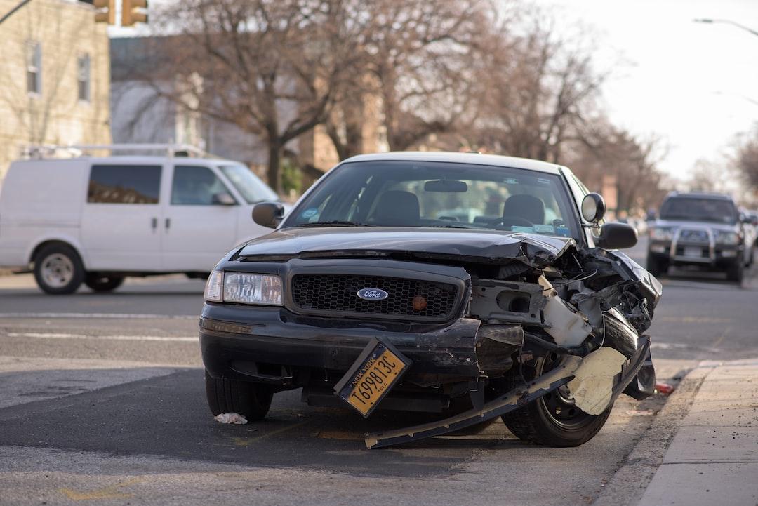 Taxi car damaged in a crash.